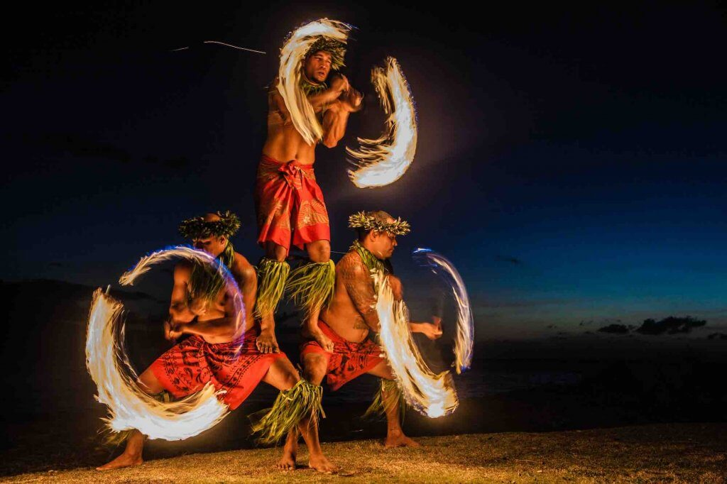 Find out if it's worth going to a luau with a toddler. Image of Three Strong Men Juggling Fire in Hawaii - Fire Dancers.
