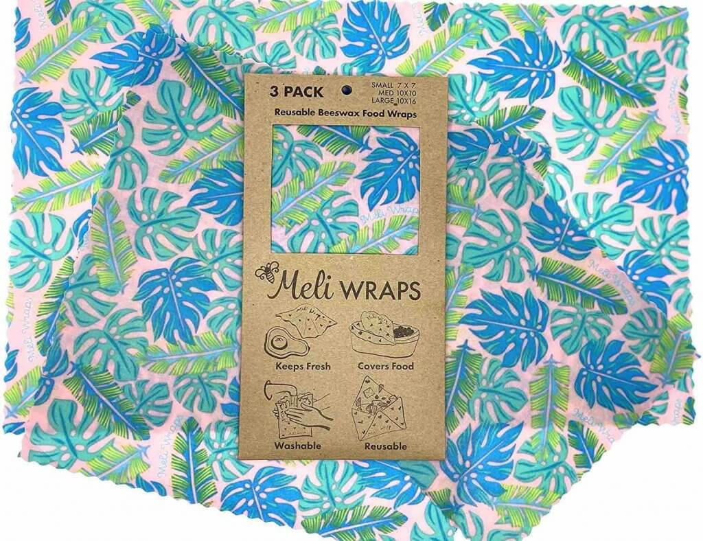 One of the most useful zero-waste essentials when it comes to food are these Meli Wraps made of beeswax. Image of a tropical leaf print reusable food wrap.