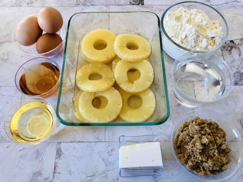 Learn how to make Pineapple Upside Down Rum Cake by top Hawaii blog Hawaii Travel with Kids. Image of cake mix, pineapple rings, eggs, butter, brown sugar, etc.