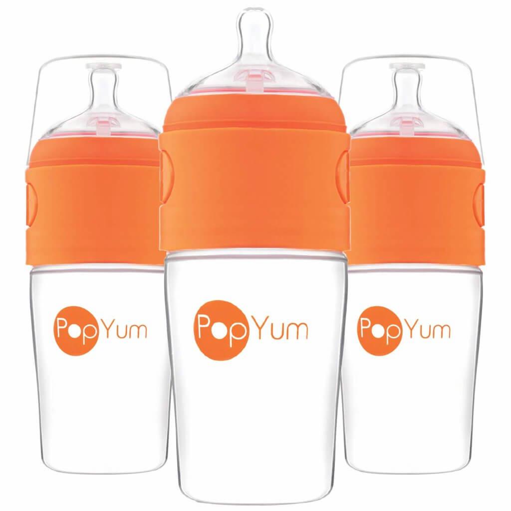 Image of 3 orange baby bottles by PopYum.