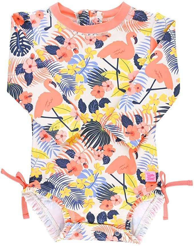SPF rash guards are beach necessities for babies in Hawaii. Image of a tropical print baby swimsuit with flamingos on it.