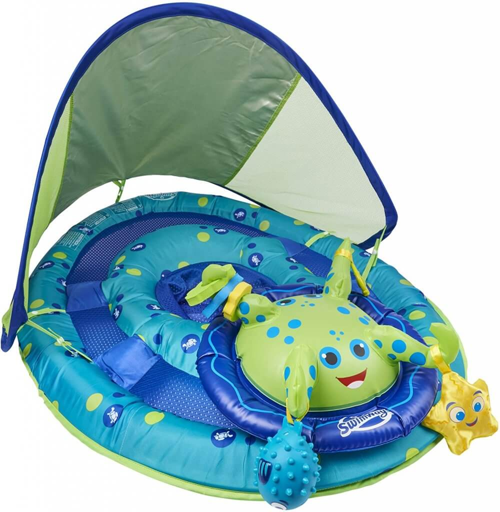 This is one of the cutest swim floats for babies because it has toys attached to it. Image of a blue and green baby pool float with baby toys attached.