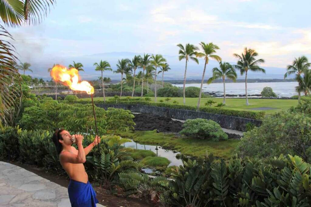 Some Hawaiian luaus offer cool torch lighting ceremonies like this.