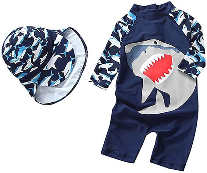 And SPF swimsuit and sun hat are the best best baby gear for beach. Image of a shark print one piece baby swimsuit and hat.