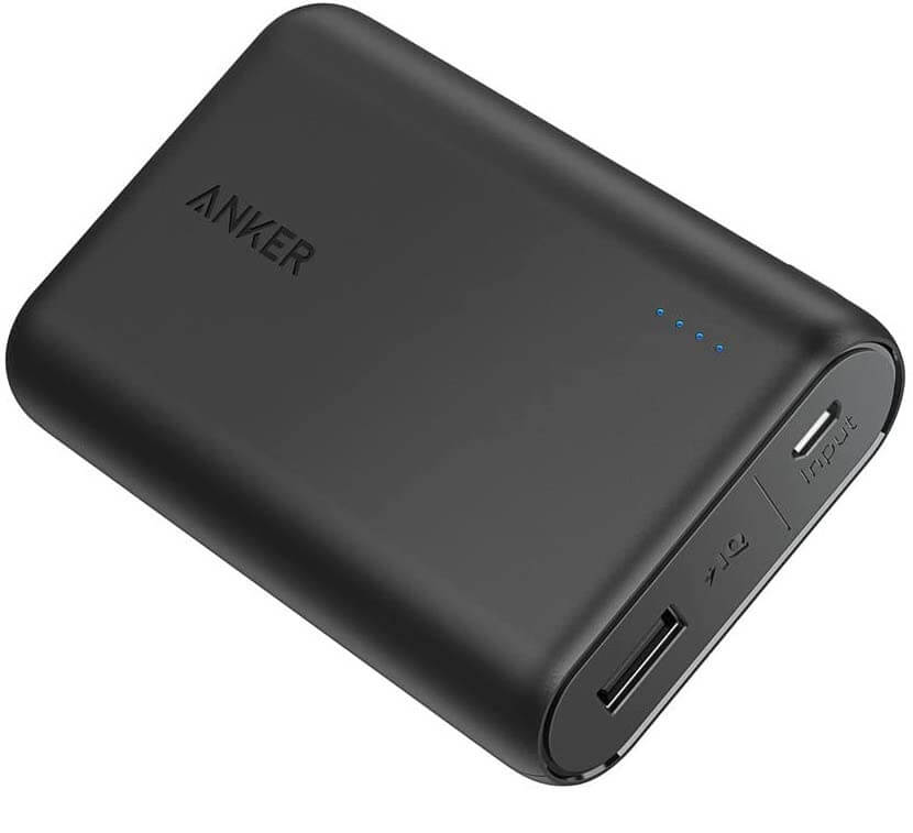 We always add portable battery packs to our Maui packing list for the airplane. Image of a black battery charger.