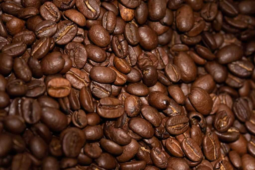 One of the best fun facts about Hawaii is that they are the only state that grows coffee to sell commercially. Image of a bunch of coffee beans.