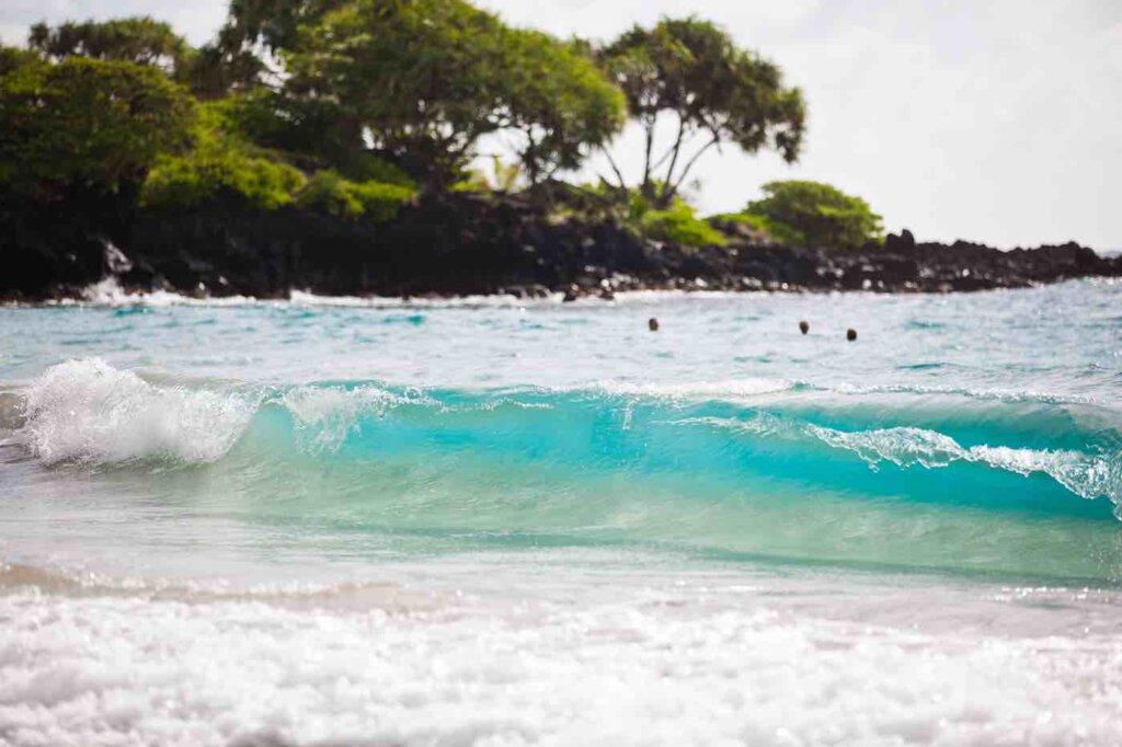 Another awesome Hana road stop is Hamoa Beach. Image of Hamoa Beach in Hana Maui. Photo credit: Hawaii Tourism Authority/Tor Johnson
