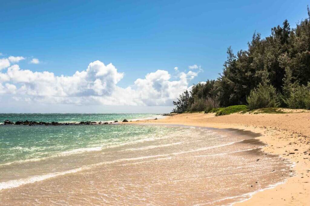 One of the best things to do in Maui on a budget is visit the beach. Image of Kanaha Beach on Maui.