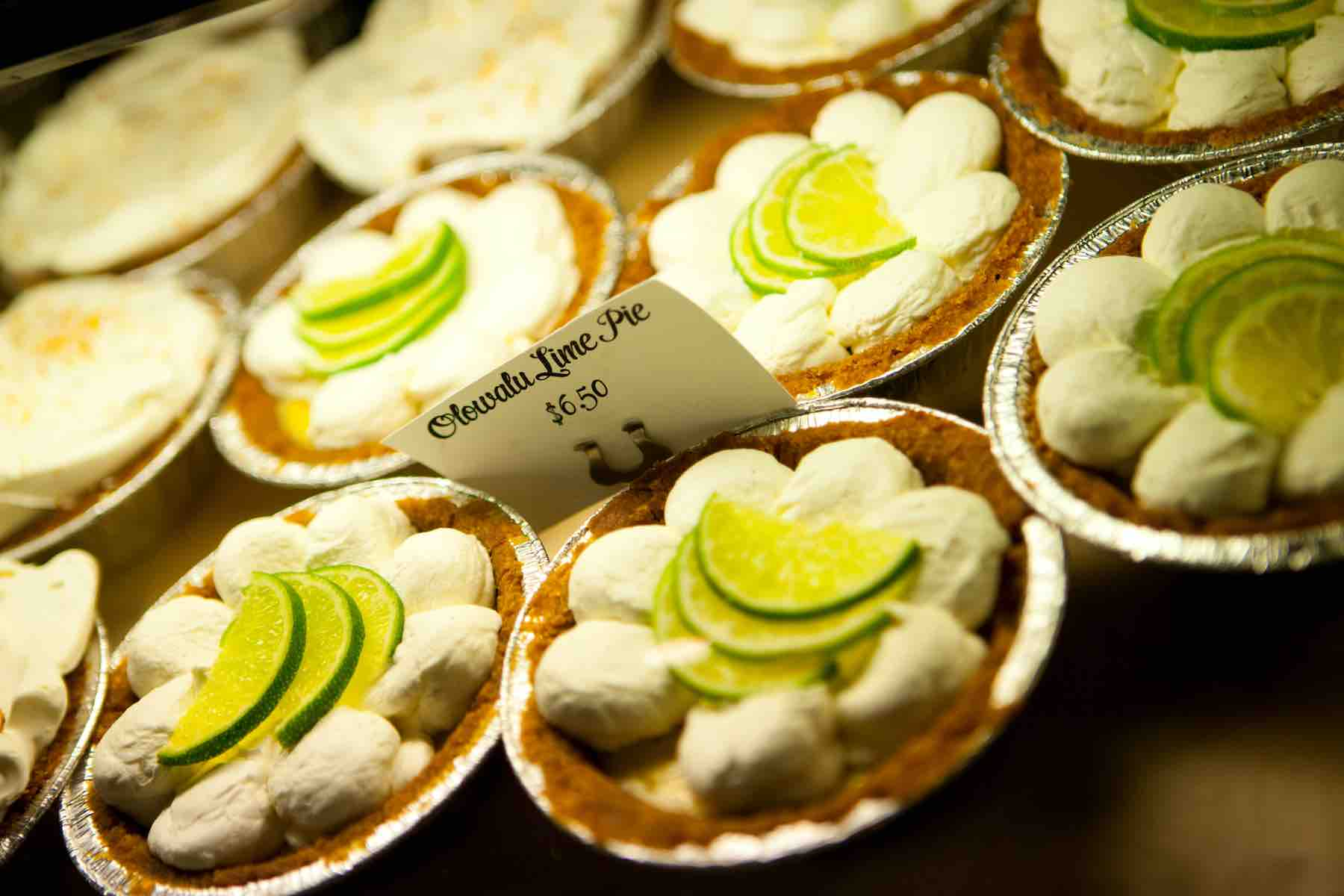 Find out the best Maui bakeries recommended by top Hawaii blog Hawaii Travel with Kids. Image of a bunch of mini key lime pies.