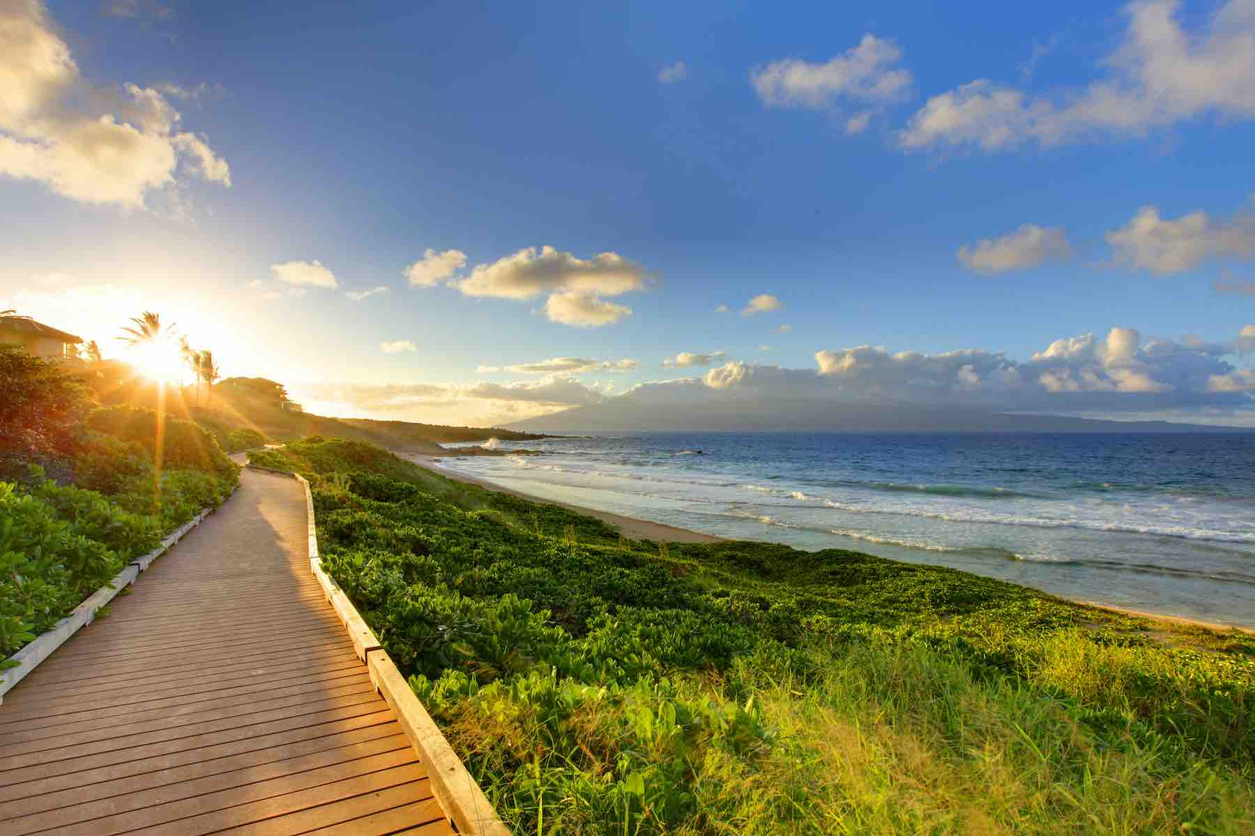 Find out the best cheap things to do on Maui on a budget by top Hawaii blog Hawaii Travel with Kids. Image of the Oneloa Beach Pathway on Maui with the ocean in the background.