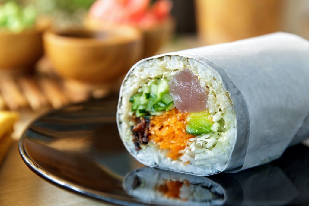 Check out this North Shore Kauai Food Tour review by top Hawaii blog Hawaii Travel with Kids. Image of a sushi burrito.