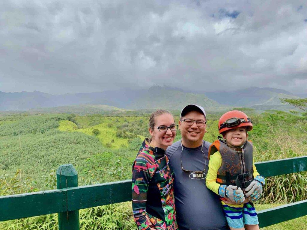 Image of a family posing at Mt. Waialeale on Kauai.