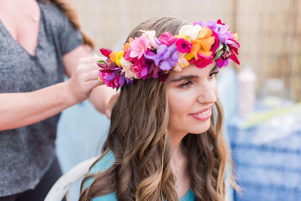 Image of a woman wearing a Hawaiian flower crown.
