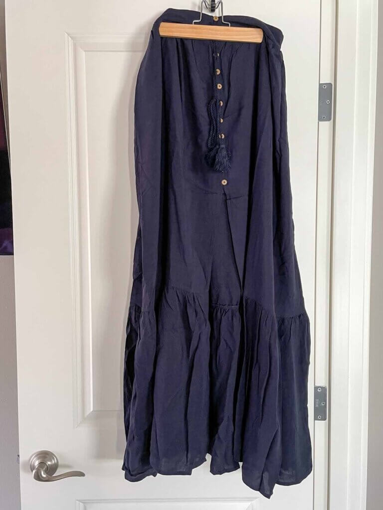Image of a navy boho chic tiered maxi skirt that came in a Wantable style box.