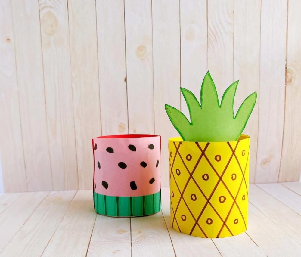 Learn how to make paper pineapple crafts for kids by top Hawaii blog Hawaii Travel with Kids. Image of a toilet paper roll pineapple and watermelon.