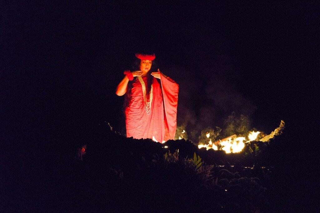 Image of Pele, the Hawaiian goddess of fire and volcanoes as she dances at a Kauai luau.