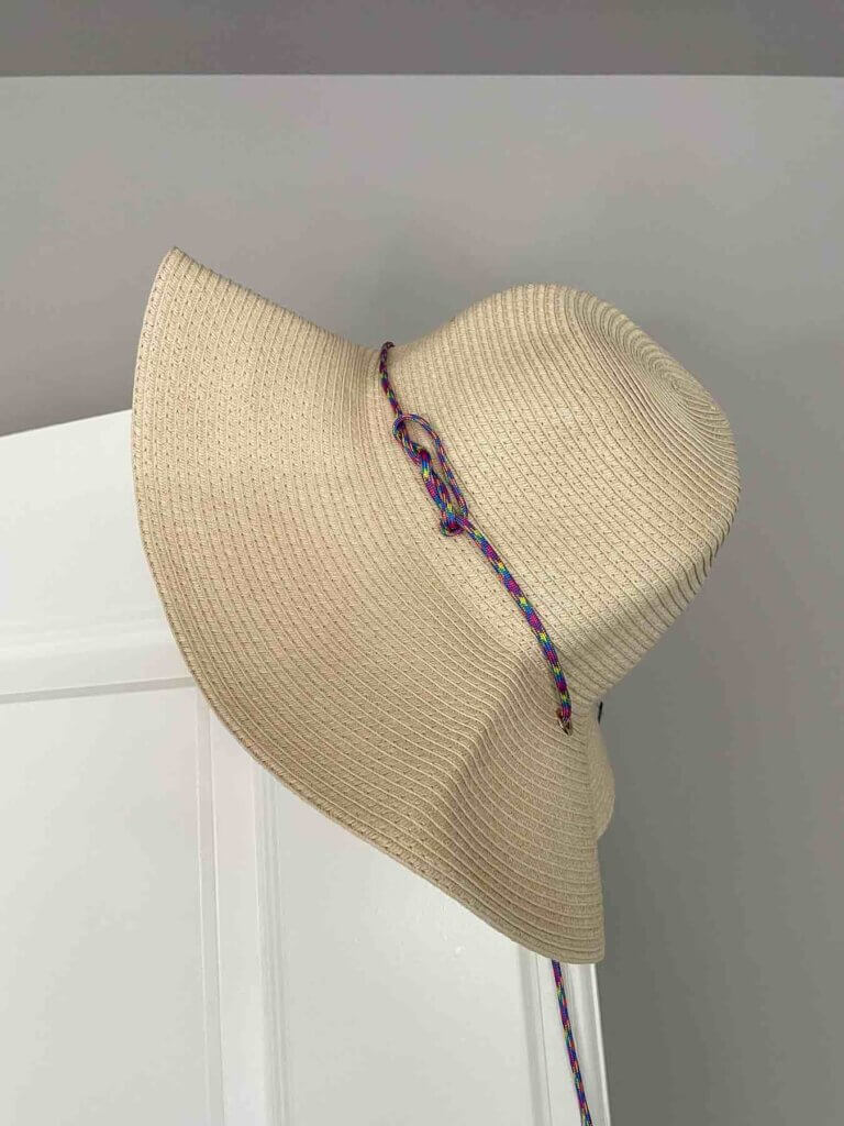 Image of a straw sun hat that's the perfect addition to any Hawaii packing list.