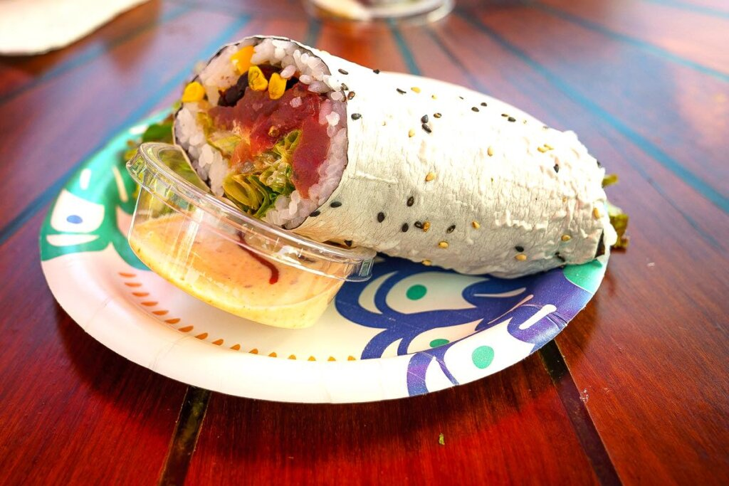 Sushi Girl is one of the first stops on this Kauai food tour. Image of a sushi burrito.