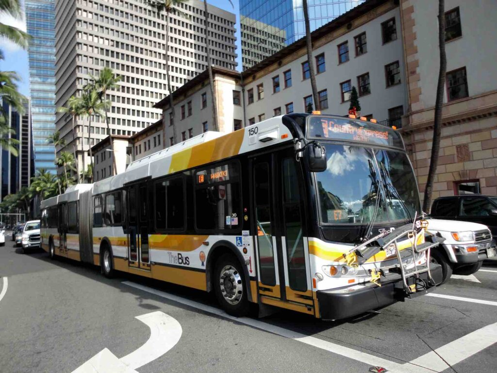 TheBus is the best public transportation on Oahu. Image of TheBus driving on Bishop Street in Honolulu.