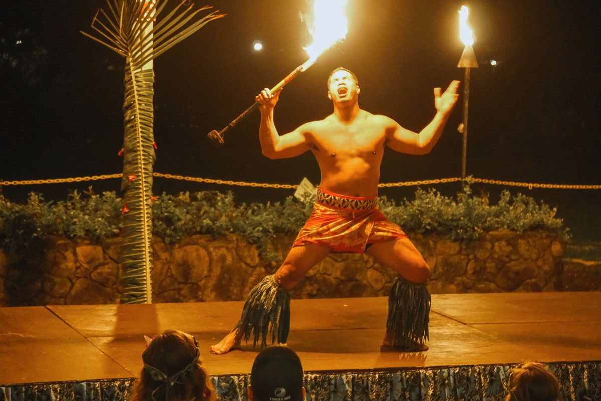 Looking for the best luaus in Oahu Hawaii? Check out this Toa Luau review by top Hawaii blog Hawaii Travel with Kids. Image of a Samoan fire knife dance outside at a Hawaii luau.
