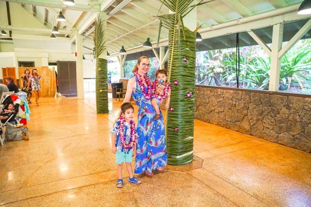 Image of a mom and two boys at Toa Luau at Waimea Valley on Oahu.