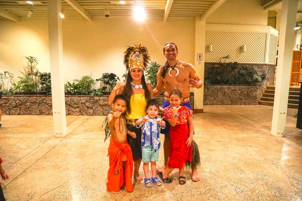Image of a Samoan family posing with a little boy at a North Shore luau on Oahu.