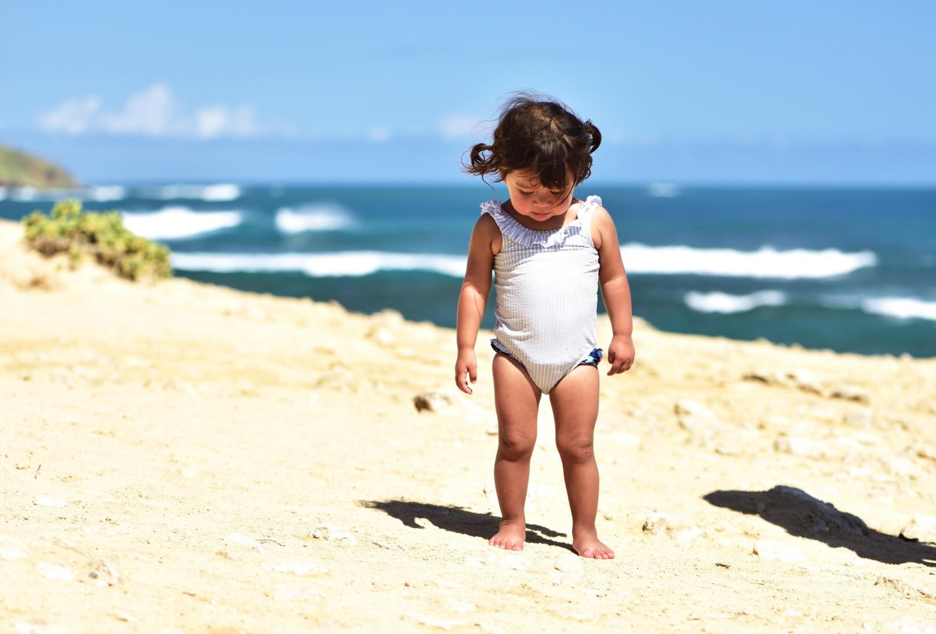 Find out the best things to do on Kauai with toddlers recommended by top Kauai blog Hawaii Travel with Kids. Image of a toddler on Kauai.