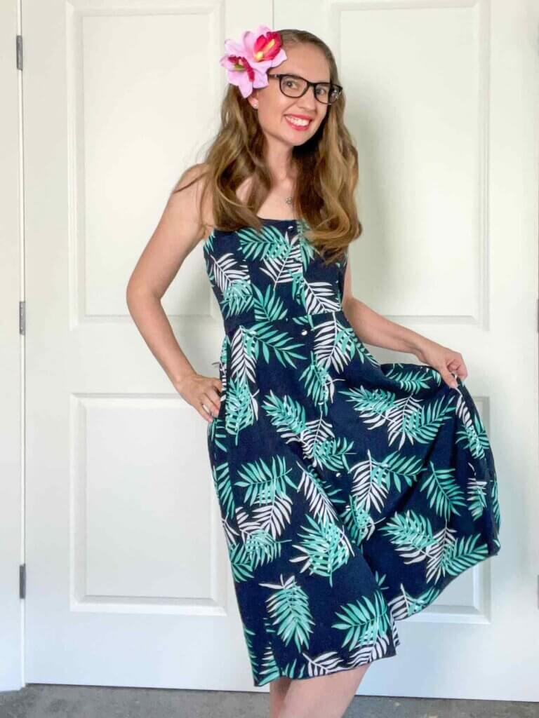 This is one of the cutest dresses to wear in Hawaii. Image of a woman wearing a tropical print dress.