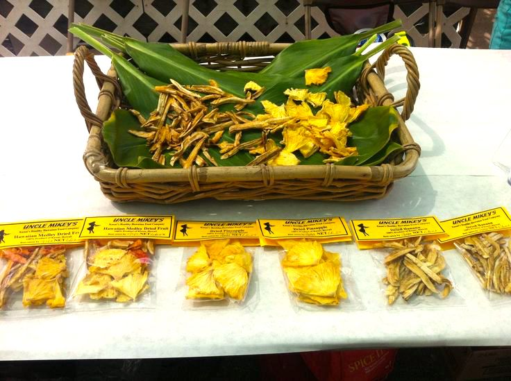 Try incredible Hawaiian dried fruit on this North Shore Kauai food tour. Image of a basket of dried pineapple and apple bananas.