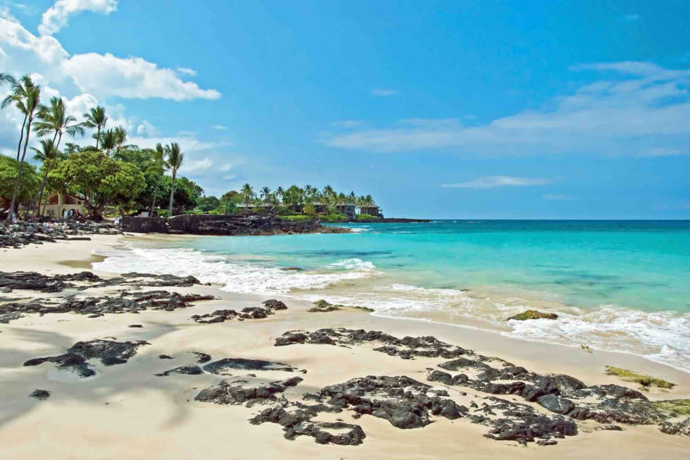 Find out where to stay on the Big Island with kids recommended by top Hawaii blog Hawaii Travel with Kids. Image of a beach on the Big Island Hawaii.