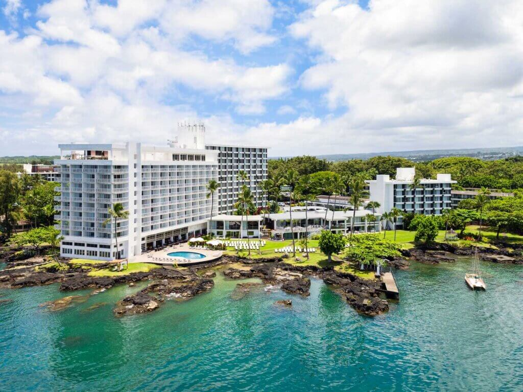The Grand Naniloa Hotel is one of the best places to stay in Hilo Hawaii. Image of an oceanfront resort in Hilo Big Island.