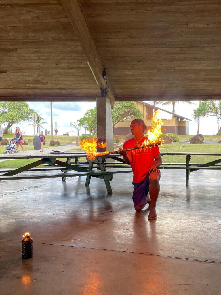 Image of a man doing Samoan fire dancing on Kauai.