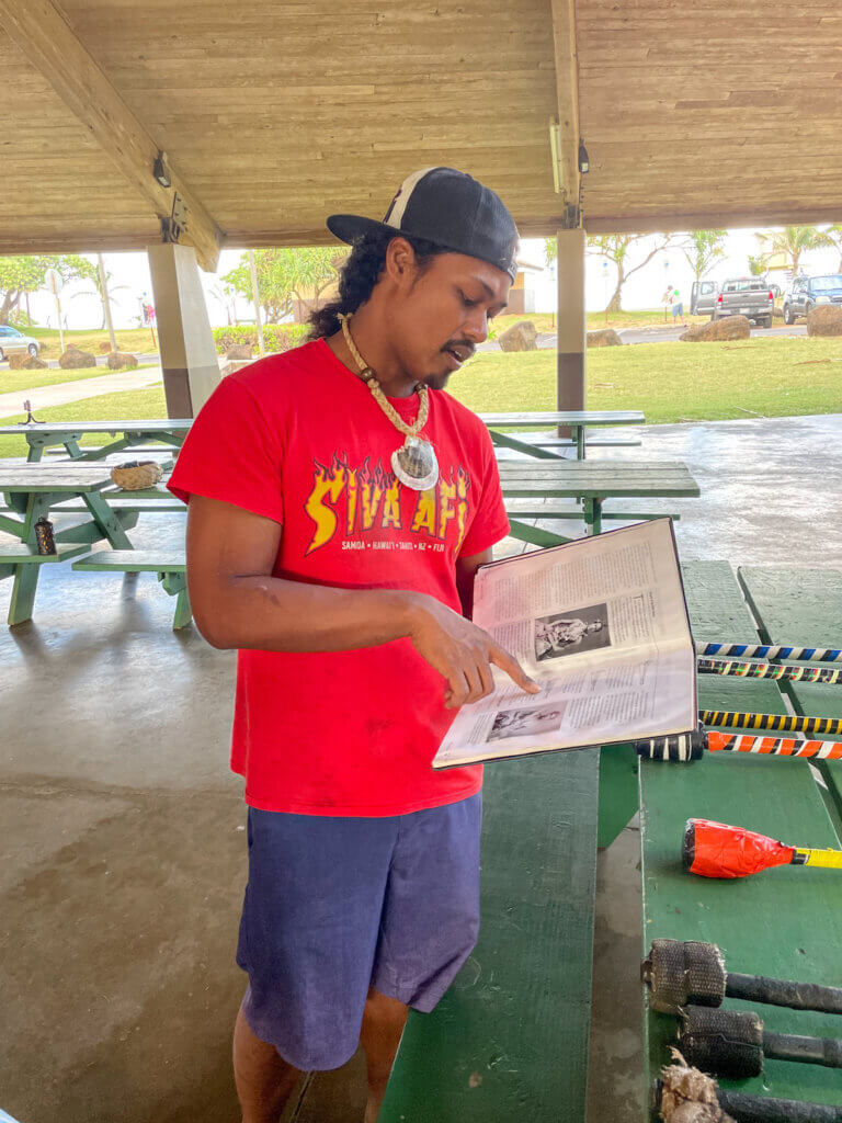 We learned a bit about Samona history and culture before this Polynesian fire dancing workshop. Image of a man reading from a book.