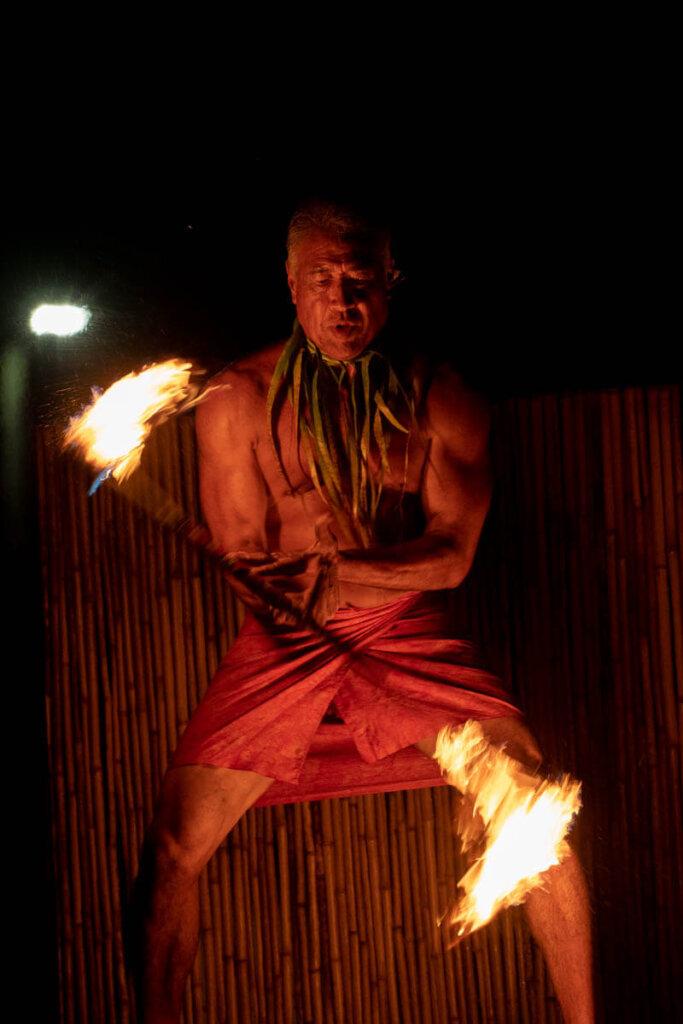 See amazing Hawaiian fire dancers at the Ahi Lele Fire Show, a new Kauai luau. Image of a man twirling fire in Hawaii.