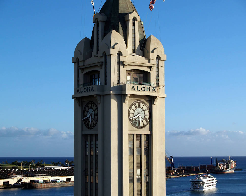 The Aloha Tower is one of the most haunted places in Hawaii because there are ghosts of WWII sailors who live here. Image of a tall tower in Hawaii.