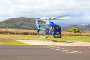 Find out the best things to do in Lihue Kauai recommended by top Hawaii blog Hawaii Travel with Kids. Image of a helicopter at Lihue Airport on Kauai.