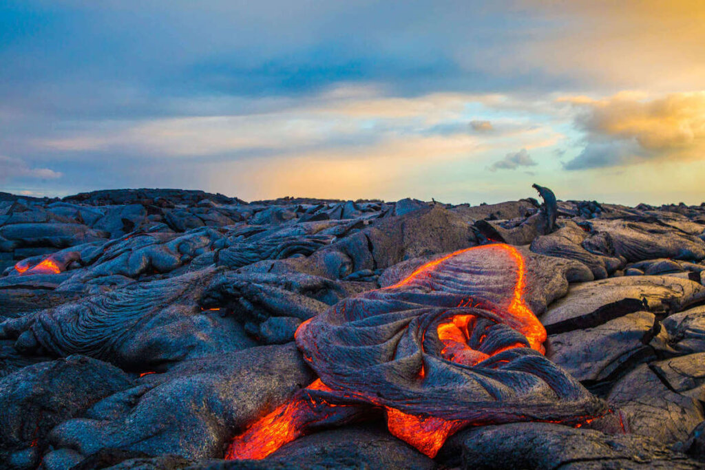 Want to see an active volcano in Hawaii? Head to Hawaii Volcanoes National Park on the Big Island. Image of lava at Hawaii Volcanoes National Park.