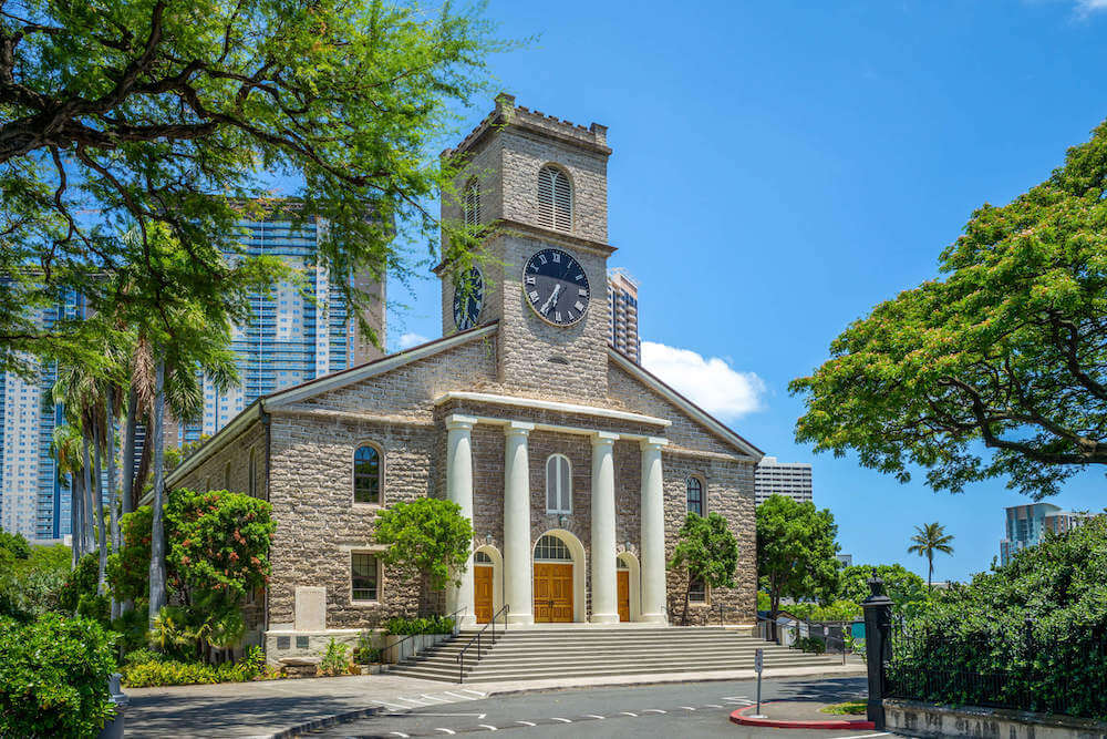 Kawaiahao Church is one of the most haunted places in Hawaii because the graveyard is frequently visited by Night Marchers. Image of the exterior of the Kawaiaha'o Church in Honolulu.