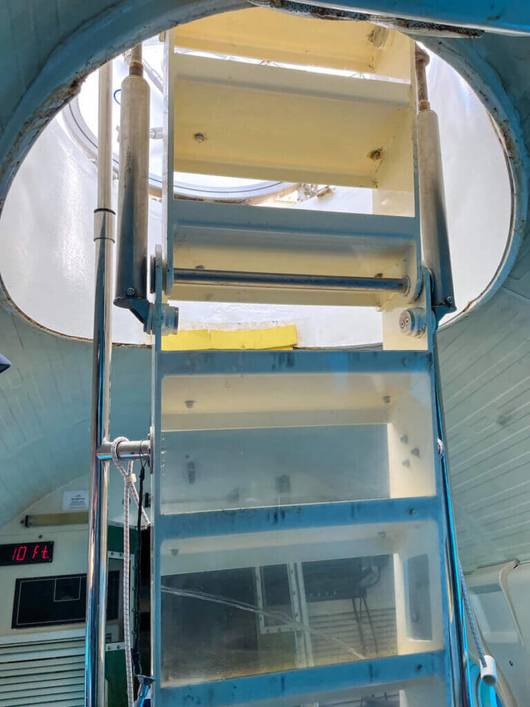In order to do the Waikiki Atlantis Submarine ride, you'll need to climb down a really steep ladder.