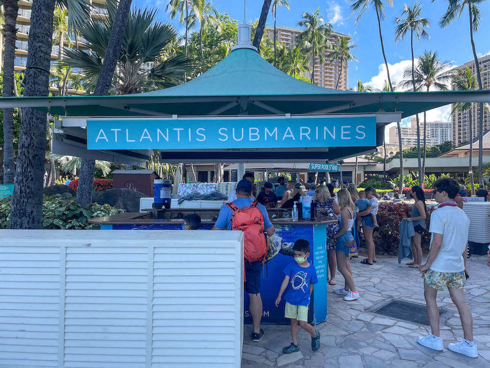 Get your Waikiki Atlantis Submarine tickets online or at the kiosk at the Hilton Hawaiian Village. Image of the Atlantis Submarine kiosk at the Hilton Hawaiian Village in Waikiki.