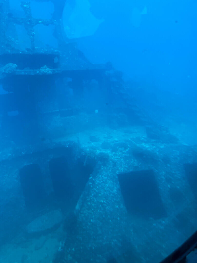 Image of an underwater ship wreck off the coast of Waikiki.