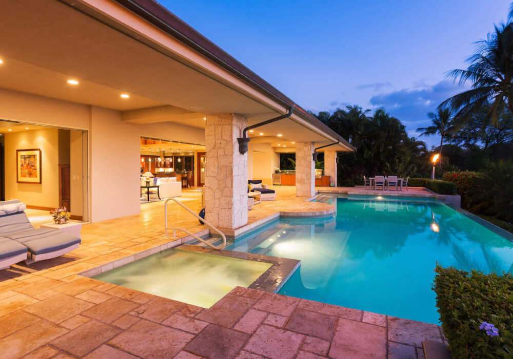 Find out the best villas in Hawaii recommended by top Hawaii blog Hawaii Travel with Kids. Image of a luxury villa with a private pool.