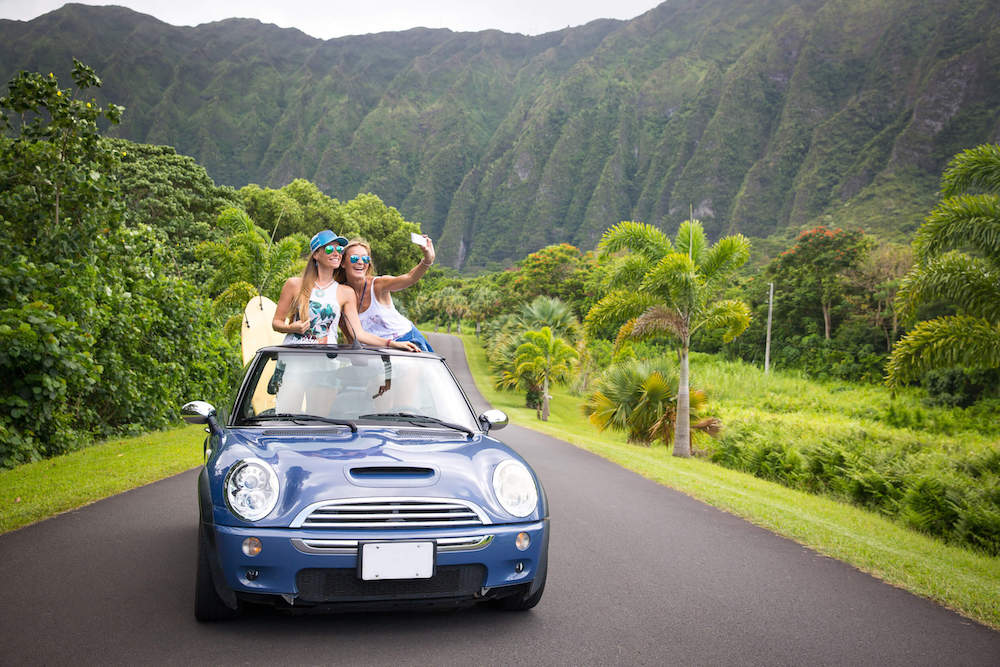 Find out the best Hawaii captions for Instagram by top Hawaii blog Hawaii Travel with Kids. Image of two women taking a selfie at Ho'omaluhia Botanical Garden on Oahu Hawaii.