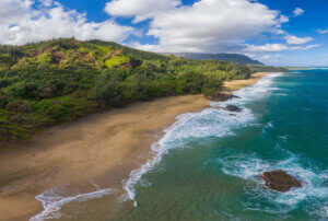 Find out the prettiest Kauai beaches worth seeing by top Hawaii blog Hawaii Travel with Kids. Image of an aerial shot of Lumahai Beach on Kauai's North Shore.