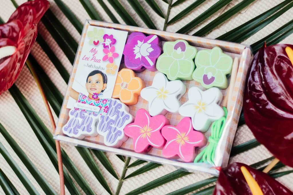 Looking for a bead threading set for toddlers? Check out this Hawaiian wooden toy where kids can string a lei.