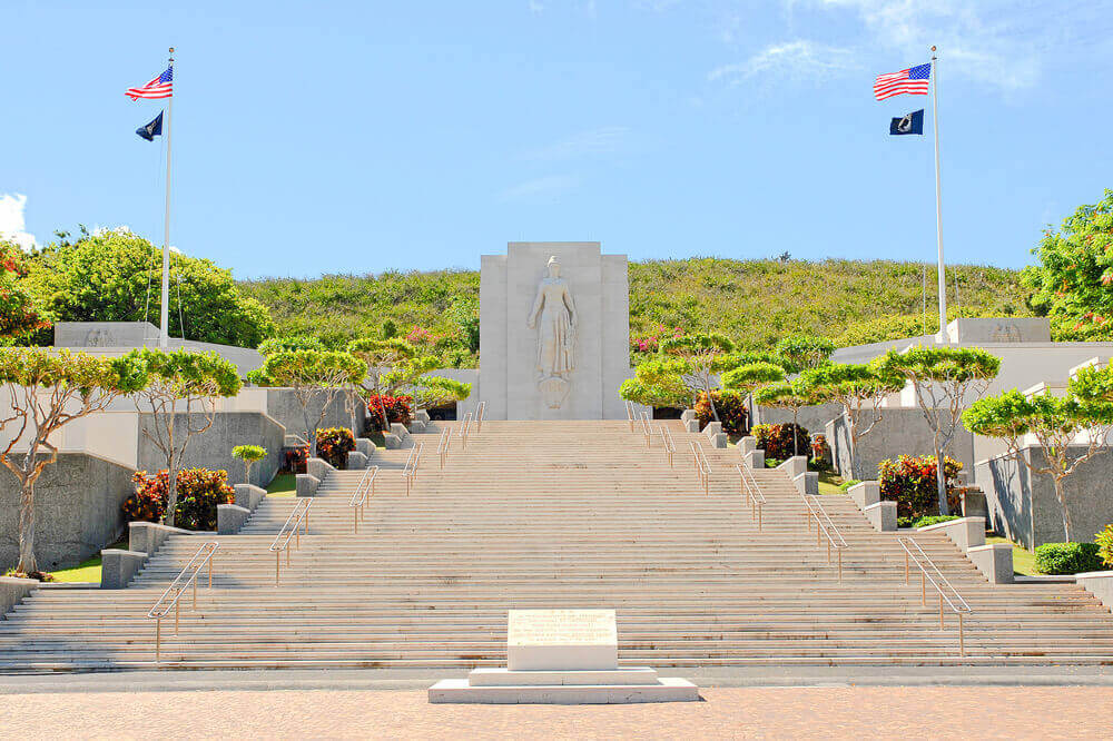 This private Pearl Harbor tour also includes a visit to the National Memorial Cemetery of the Pacific at Punchbowl. Image of a bunch of stairs leading up to a monument.