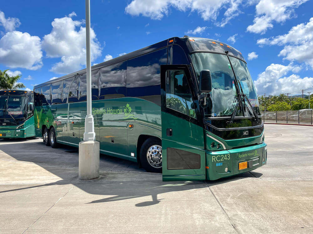 Hop on the free Pearl Harbor shuttle that takes you to all the Pearl Harbor Attractions, including the USS Battleship Missouri. Image of a green Roberts Hawaii tour bus.