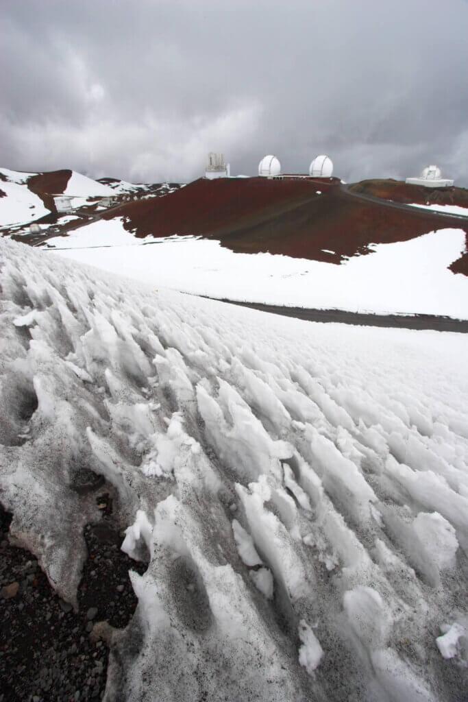 Find out how to go skiing at Mauna Kea on the Big Island of Hawaii. Image of snow at Mauna Kea summit.