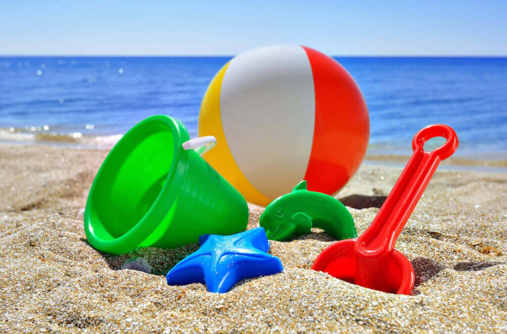Find out the best things to buy in Hawaii to save money recommended by top Hawaii blog Hawaii Travel with Kids. Image of sand toys on a beach in Hawaii.