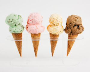 Find out the best Oahu Ice Cream Spots by top Hawaii blog Hawaii Travel with Kids. Image of 4 ice cream cones.
